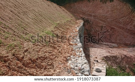 Hydroseeded grass along the slope surface using Singal Grass variety for slope protections. The growth after 10 days application and without fibromat cover.  Royalty-Free Stock Photo #1918073387