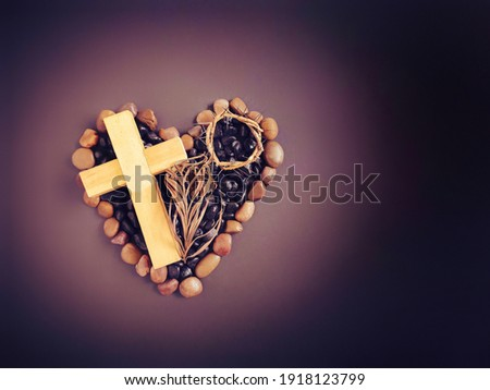 Lent Season,Holy Week and Good Friday concepts - wooden cross image in vintage background. Stock photo.