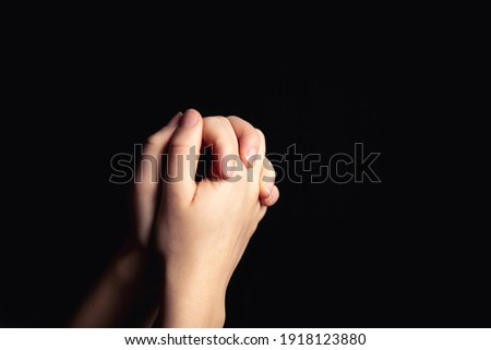 Praying hands with faith in religion and belief in God on blessing background. Power of hope or love and devotion in the dark with copy space , space for text Royalty-Free Stock Photo #1918123880