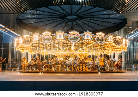 48-horse Merry-Go-Round wooden carousel ride at fair Lit up at night. Royalty-Free Stock Photo #1918305977