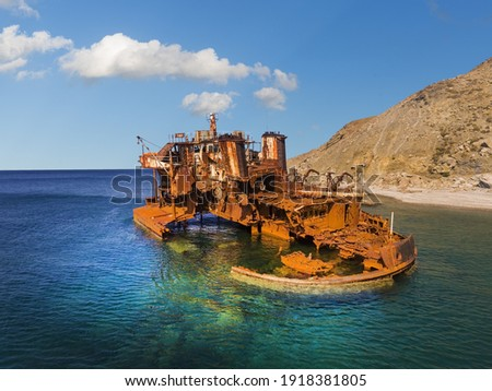 Rusty iron wreck of a ship on the coast of the Greek island of Limnos in the North Aegean Royalty-Free Stock Photo #1918381805
