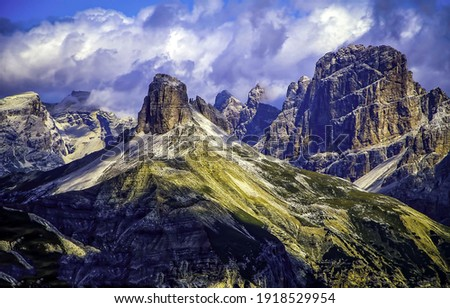 Mountain peaks on cloudy sky background. Mountain peaks view. Mountain peaks landscape. Mountain peaks Royalty-Free Stock Photo #1918529954