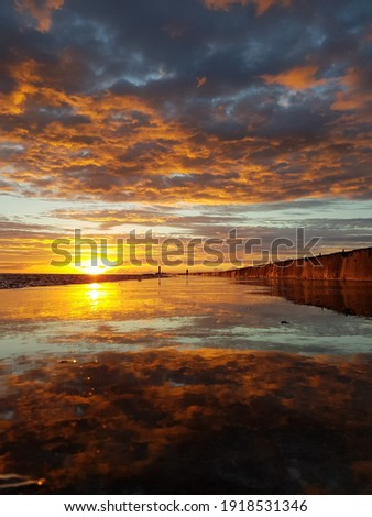 Beautiful sunset above the sea. Royalty-Free Stock Photo #1918531346