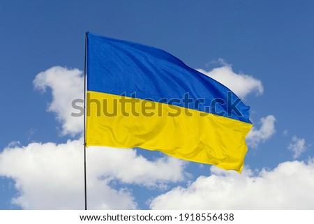 Ukraine flag isolated on the blue sky with clipping path. close up waving flag of Ukraine. flag symbols of Ukraine. Royalty-Free Stock Photo #1918556438