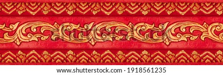 Floral seamless Asian style ornament painted in gold and red. Golden seamless wood carving ornament red background. Seamless vintage pattern texture Royalty-Free Stock Photo #1918561235