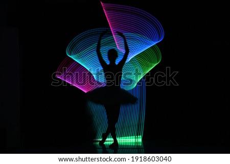 Silhouette photo of ballerina light painting technique