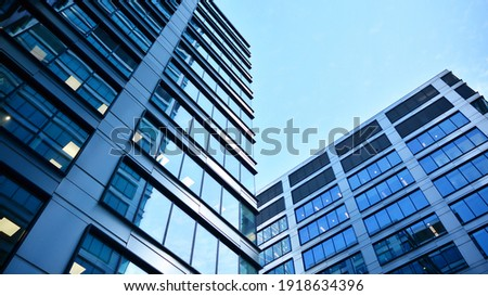 Bottom view of modern skyscrapers in business district against blue sky. Looking up at business buildings in downtown. Royalty-Free Stock Photo #1918634396
