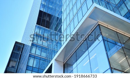 Bottom view of modern skyscrapers in business district against blue sky. Looking up at business buildings in downtown. Royalty-Free Stock Photo #1918666733