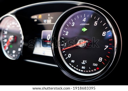 Close up shot of a tachometer in a car. Car dashboard. Dashboard details with indication lamps. Car instrument panel. Dashboard with speedometer, tachometer, odometer. Car inside Royalty-Free Stock Photo #1918683395