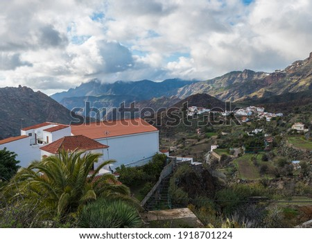 Picturesque Canarian village Tejeda in mountain valley scenery and view of Caldera de Tejeda Gran Canaria, Canary Islands, Spain Royalty-Free Stock Photo #1918701224