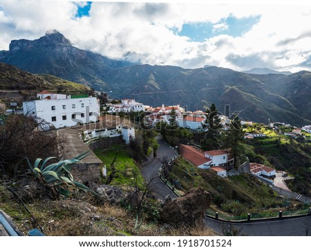 Picturesque Canarian village Tejeda in mountain valley scenery with road serpentine and view of Caldera de Tejeda Gran Canaria, Canary Islands, Spain Royalty-Free Stock Photo #1918701524