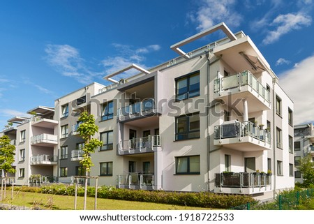 Modern apartment building in the countryside in a residential area of a city Royalty-Free Stock Photo #1918722533