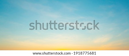 The morning sky looked like a bright golden sky. The sunrise is decorated with clouds in various shapes. Looks beautiful. Royalty-Free Stock Photo #1918775681