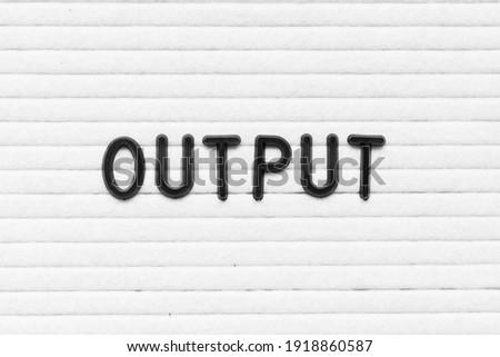Black color letter in word output on white felt board background