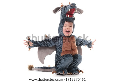 Cute baby boy in dragon costume. Royalty-Free Stock Photo #1918870451