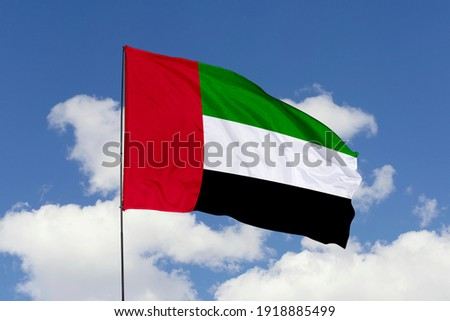 United Arab Emirates flag isolated on the blue sky with clipping path. close up waving flag of United Arab Emirates. flag symbols of United Arab Emirates. Royalty-Free Stock Photo #1918885499