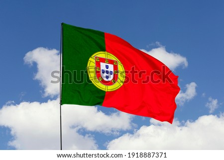 Portugal flag isolated on the blue sky with clipping path. close up waving flag of Portugal. flag symbols of Portugal. Royalty-Free Stock Photo #1918887371