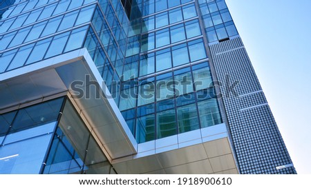 Bottom view of modern skyscrapers in business district against blue sky. Looking up at business buildings in downtown. Royalty-Free Stock Photo #1918900610