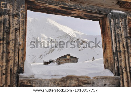 View of winter landscape through a cabin window