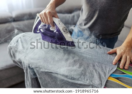 A man who is good at doing household chores. Ironing and stacking clothes during the daylight, taking responsibilities, family man or single male person