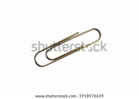 Paper clip isolated on white background. Royalty-Free Stock Photo #1918976639