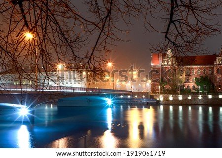 view of the river and buildings on the banks of the odra river in wroclaw in poland Royalty-Free Stock Photo #1919061719