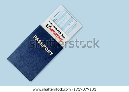 Travel passport, boarding pass and negative test result of COVID-19 PCR test. Concept of new normal future air or land border travel with proof of Coronavirus testing requirement. Royalty-Free Stock Photo #1919079131