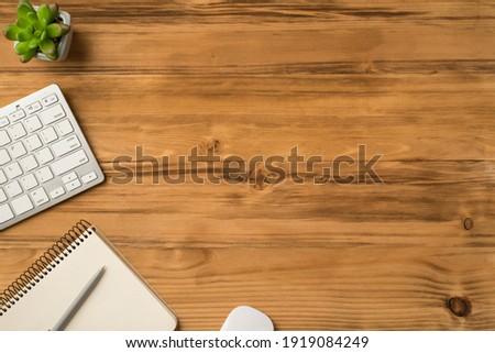 Overhead above close up flat lay view photo picture of computer keyboard mouse and plant isolated brown backdrop with copy space