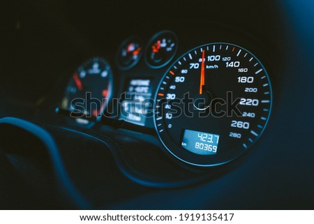 Close up shot of a speedometer in a car. Car dashboard with details with indication lamps and instrument panel. Modern interior. Royalty-Free Stock Photo #1919135417