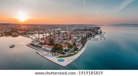 Aerial panoramic drone shot of Zadar old town sea organ in sunrise hour in Croatia Dalmatia area Royalty-Free Stock Photo #1919185859