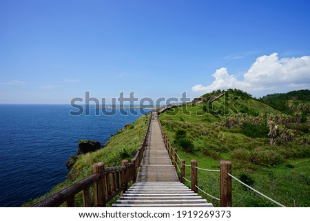 a fine walkway at a seaside cliff Royalty-Free Stock Photo #1919269373