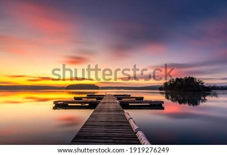Sunset lake pier landscape view Royalty-Free Stock Photo #1919276249