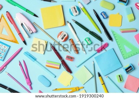 Flat lay composition with different school stationery on light blue background. Back to school Royalty-Free Stock Photo #1919300240