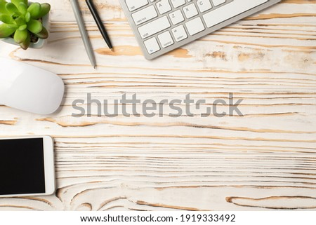 Above flat lay close up view photo picture of computer keyboard pen flowerpot mouse smart digital device isolated white wooden backdrop with mock up