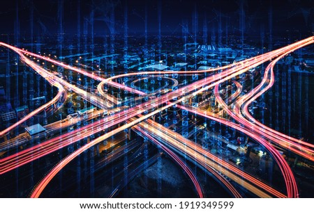 Futuristic road transportation technology with digital data transfer graphic showing concept of traffic big data analytic and internet of things . Royalty-Free Stock Photo #1919349599
