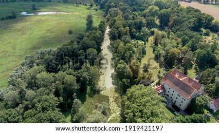 Castle in Czerna in Lower Silesia (Poland), surrounded by the Odra River backwaters. Royalty-Free Stock Photo #1919421197