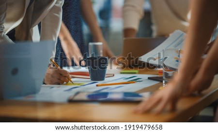 Diverse Multi-Ethnic Team of Professional Businesspeople Meeting in the Modern Office Conference Room. Creative Team Gathers Around Table to Discuss Plan Strategy. Close-up Shot with Focus on Hands Royalty-Free Stock Photo #1919479658