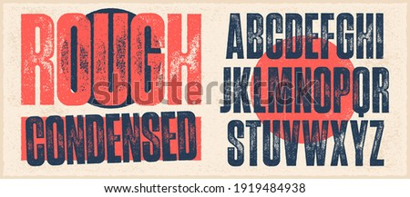 Rough Condensed Font. Works well at small sizes. Detailed individually textured characters with an eroded rough letterpress print texture. Unique design font Royalty-Free Stock Photo #1919484938