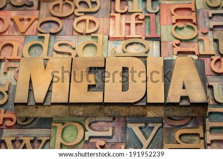 media word in wood type against background of letterpress printing blocks Royalty-Free Stock Photo #191952239
