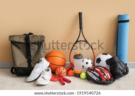 Set of sport equipment on floor near color wall Royalty-Free Stock Photo #1919540726