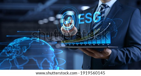 ESG environmental social governance business strategy investing concept. Businessman pressing button on screen. Royalty-Free Stock Photo #1919560145