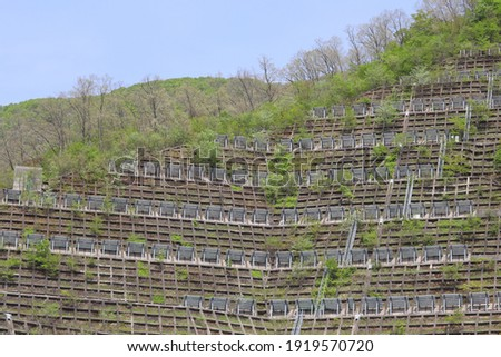 Surface of a mountain with slope stabilization work done Royalty-Free Stock Photo #1919570720
