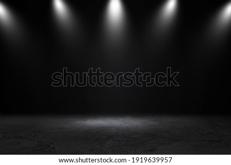 Product showcase with spotlight. Black studio room background. Use as montage for product display  Royalty-Free Stock Photo #1919639957