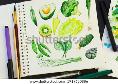 Watercolor set of green vegetables: avocado, kiwi, asparagus, cucumber, onion, peas, artichoke, broccoli, bell pepper, okra, spinach, lettuce.