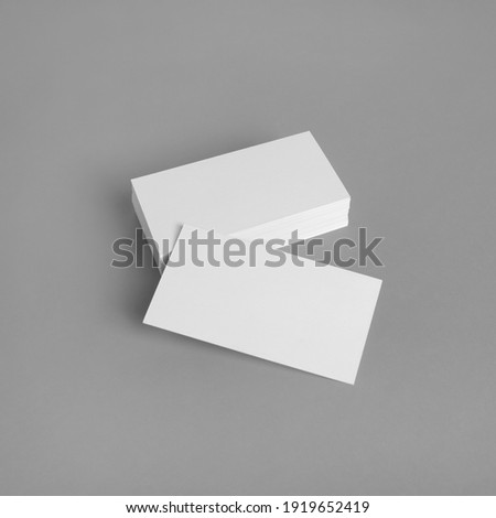 Photo of blank business cards on gray background. Template for ID.