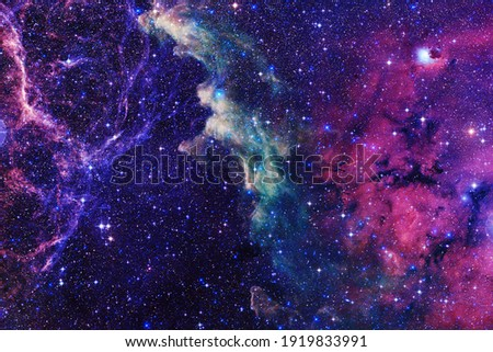 Endless universe with stars and galaxies in outer space. Cosmos art. Elements of this image furnished by NASA. Royalty-Free Stock Photo #1919833991