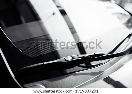 close up of front Windshield Wipers on a black new car in salon. selective focus. Royalty-Free Stock Photo #1919837201