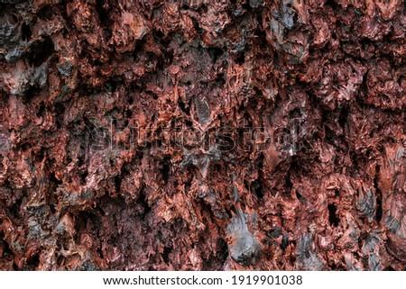 Solidified reddish lava at the volcano Piton de la Fournaise, Reunion, France