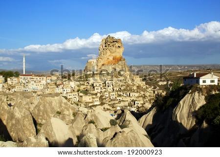 Town and Ortahisar castle at sunset, Cappadocia, Turkey #192000923