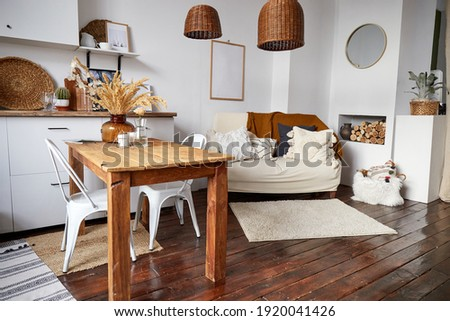Modern minimal home interior in eco style. A natural bright apartment in trendly style. Decorative straw lamp. Royalty-Free Stock Photo #1920041426